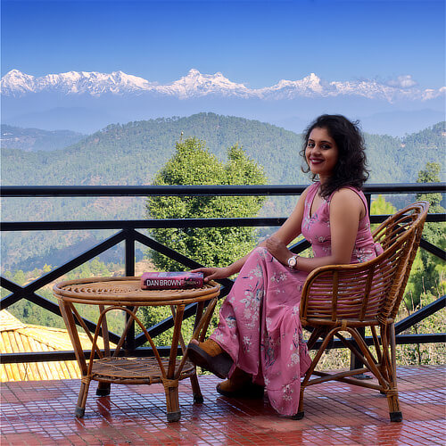Relaxing in front of the Himalayas