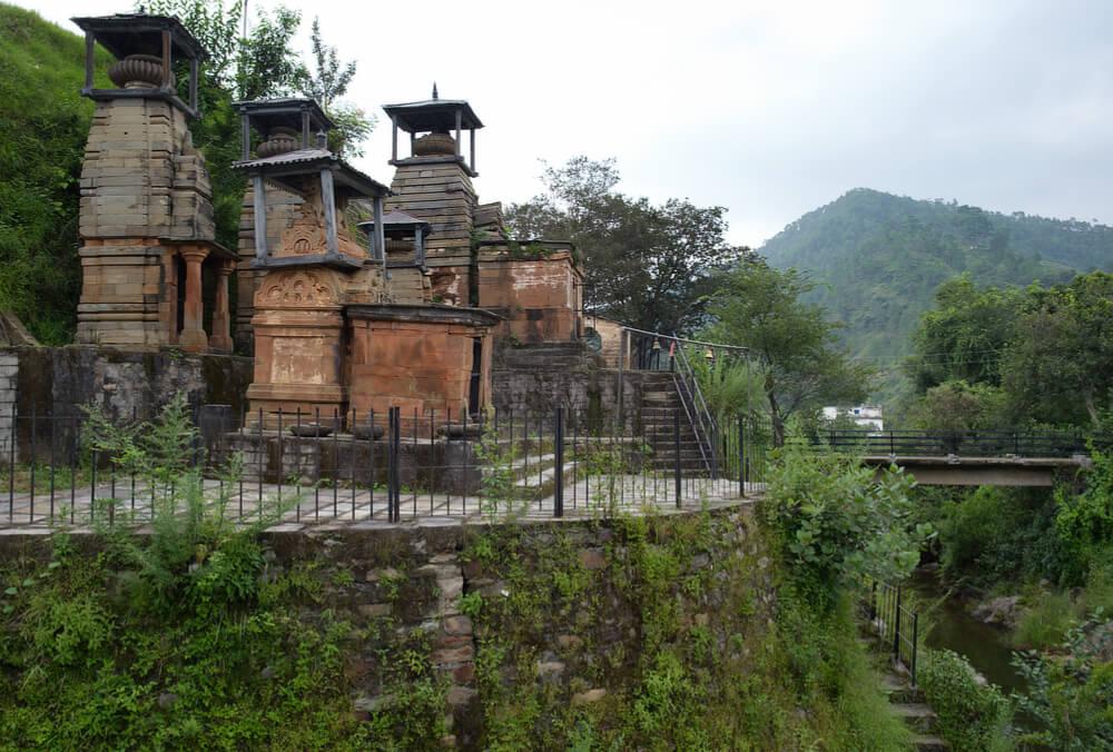 Trinetra Mahadeva Temples next to a mountain stream
