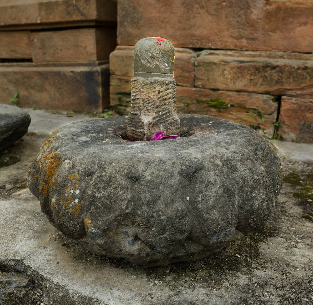 Stone from top of a temple, with a shivling